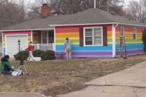 The house across from Wesboro Church is painted in rainbow colors.